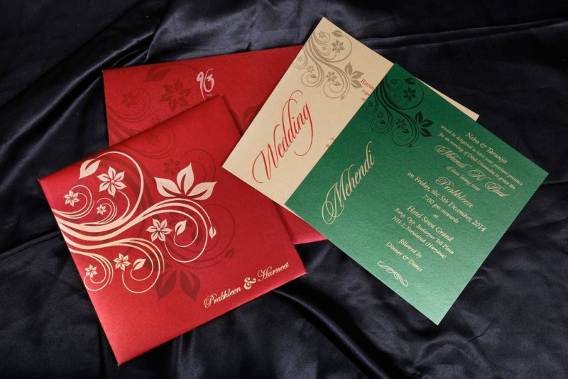 Wedding Card in Royal Red with Golden Floral Design