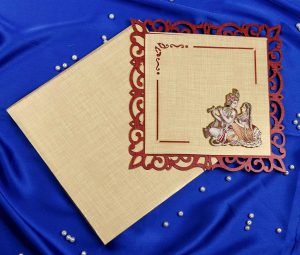 Radha Krishna Laser Cut Wedding Card in Golden Red