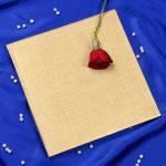 Envelope of Radha Krishna Laser Cut Wedding Card in Golden Red